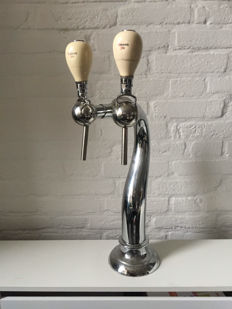 beautiful beer tap with handles by Dommelsch.