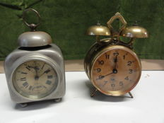 Two antique alarm clocks - period 1920.