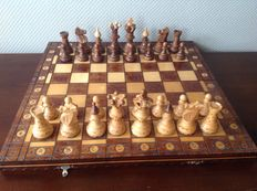 Old Austrian hand-carved wooden chess set