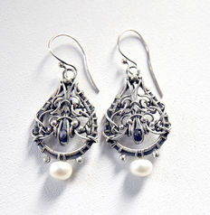 Silver earrings and freshwater pearls  white 10 mm,  sapphire is  not transparent 0.11ct. dark blue colour.