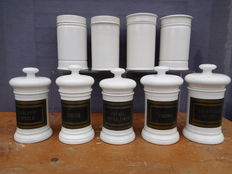 Nine white porcelain potsharmacists pots