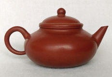 A Yixing plain red mud tea pot - China - late 20th century