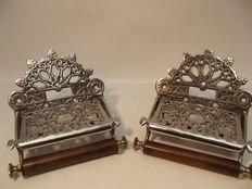 Set of identical silver plated oilet paper holders in Victorian style, 21st century