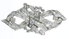 Late Art Deco platinum and diamond double clip brooch with a  total diamond weight 4.80 ct.
