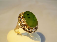 Golden ring with large jade plate (Canada)