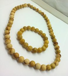 Bracelet and necklace of Baltic amber, weight is 60,87  g