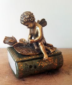 Detailed porcelain jewellery box with bronze angel