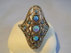 Ring with blue opals