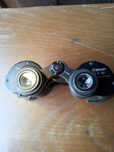 Lot consisting of 1950s Canon binoculars with lens correction