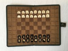 Antique leather travel chess set, 19th century