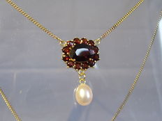 Gold garnet necklace with authentic, white pearls.
