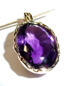 Pendant in 585/14 kt with 20 ct large amethyst faceted