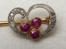 Yellow and white gold pin with rose cut diamonds and rubies