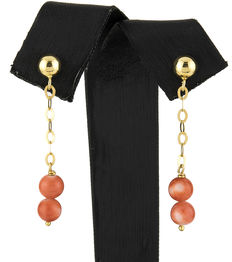 Long yellow gold dangle earrings with natural Pacific coral beads.