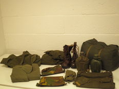 Eleven military clothing items and accessories