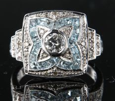 14 kt white gold ring in Art Deco style with blue topaz and brilliant cut diamond
