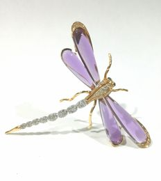 Brooch-pendant, 18 kt gold diamonds and amethysts.
