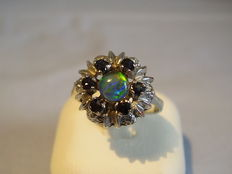 Women's ring with opal and sapphire entourage, in total 0.27 ct