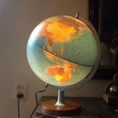 Globe on wooden foot with lighting
