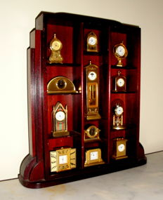A Beautiful Collection of 12 Miniature Clocks in a Walnut Exhibitor