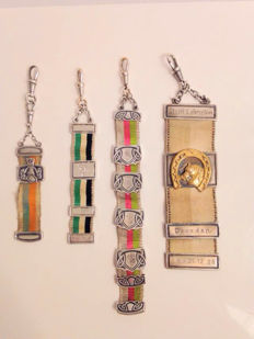 Four partly silver chatelaine pocket watch chains