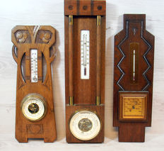 Three x Art Deco barometers  / thermometers - on hand carved wooden background