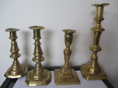 Four old brass candlesticks - 19th century.