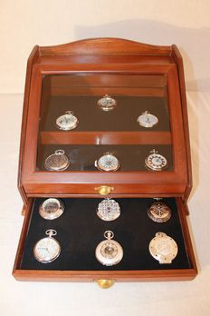 18 pocket watches, in their display case, from 1980.