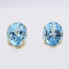 14 karat gold earrings with large Swiss blue topaz of 11 x 9 mm