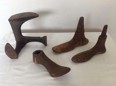 Collection antique shoe lasts and shoemaker anvil