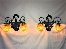Two antique French wrought iron wall fixtures with glass shades. Counterparts