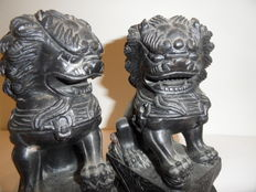 Two black stone temple lions – China – mid 20th century