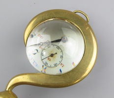 Porte montre in the shape of a question mark with bulbous enlarged lens - ca. 1900