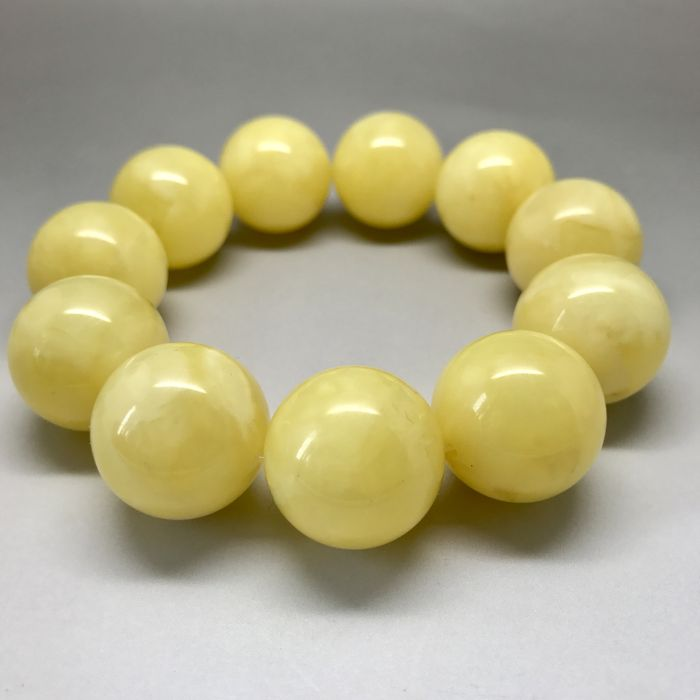 Natural Baltic amber bracelet of large beads 18.7 mm in diameter, weight 40 grams, butter colour