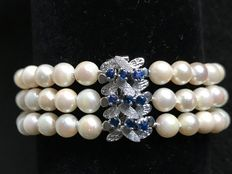 Bracelet with three strands of Akoya pearls, 5.8 mm, and 9 sapphires, 0.45 ct with gold clasp, from 20th century