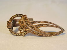 A silver scarf clip with marcasites