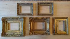 Five pieces, gold brocante frames with ornamental corners.