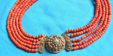 Antique 14 kt gold filigree clasp attached to a 5 string red coral necklace
