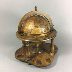 Pot with a lid in the shape of a globe with an antique map.