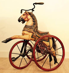 Wooden horse wrought iron tricycle.