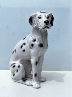 Glazed earthenware sculpture of a Dalmatian.