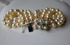 3-row pearl bracelet with genuine round Japanese Akoya saltwater pearls and a beautiful white gold handcrafted clasp with small Emeralds and pearls