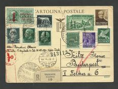 Italian Social Republic, 1944 - Full postcard, with complemetary stamps, from Trieste to Budapest.