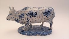 Antique blue decorated bull on stand