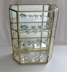 Small display case cabinet with glass miniature animal figures