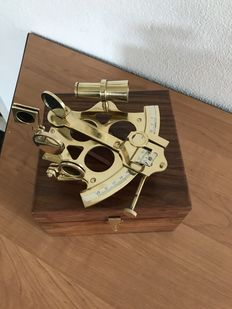 Large brass sextant in wooden box.