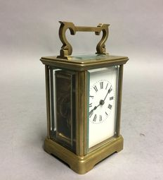 Old carriage clock - brass casing - period 1900.