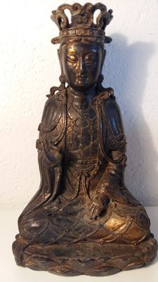 A Guan Yin statue once had gilding - China - 19th century