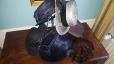 Collection of ladies hats/caps with metal suppor stand