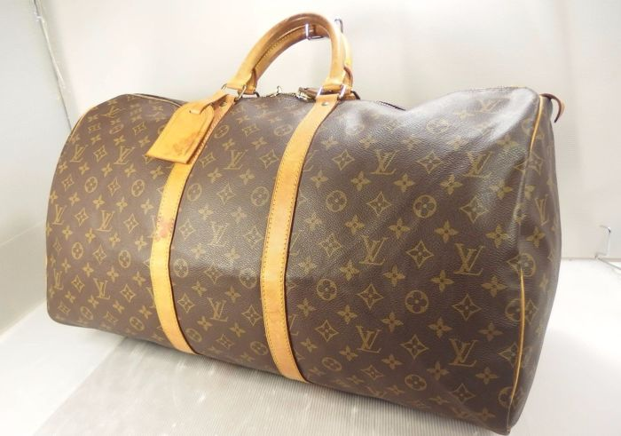 bdc19987441e Louis Vuitton – Keepall 55 Travel bag with nametag and LV padlock without  key